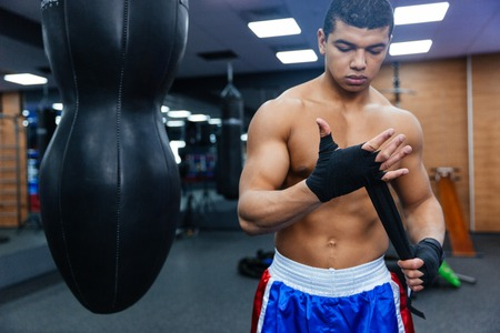 knockdown: Boxer getting ready for fight in gym Stock Photo