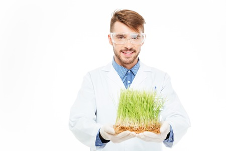 scientific farming: Happy male engineer showing a modified plants isolated on a white background Stock Photo