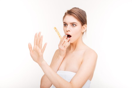 emery: Beauty portrait of shocked young woman with emery board looking at her nails over white background