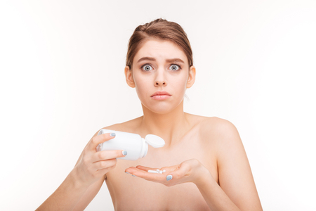 antidepressant: Young woman holding bottle with antidepressant pills isolated on a white background