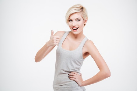 Cheerful young woman showing thumb up isolated on a white background Stok Fotoğraf