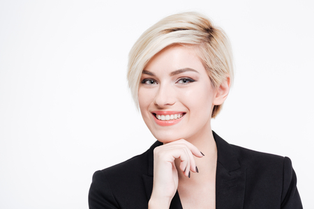 Happy businesswoman looking at camera isolated on a white background