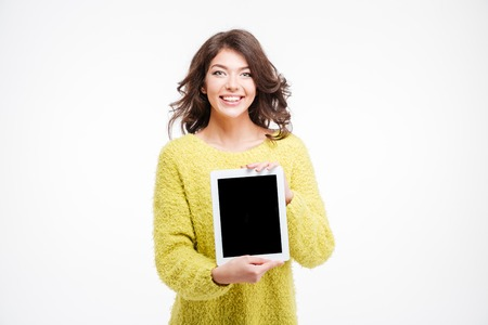 e book device: Smiling casual woman showing tablet computer isolated on a white background