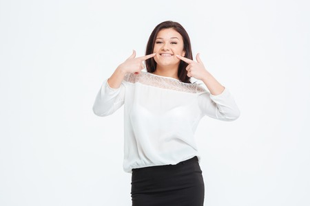 herself: Smiling businesswoman pointing finger at herself isolated on a white background Stock Photo