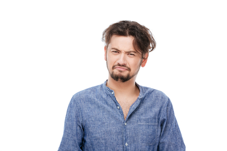 delusion: Sad man standing isolated on a white background Stock Photo