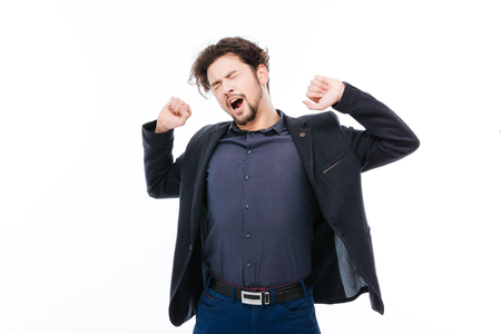 somnolence: Young businessman yawning isolated on a white background