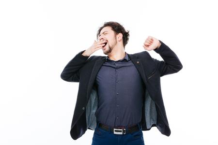 Tired businessman yawnig isolated on a white background