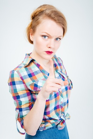 wagging: Angry woman wagging finger isolated on a white background Stock Photo