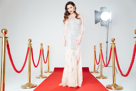 ful: Ful llength portrait of a charming woman walking on red carpet