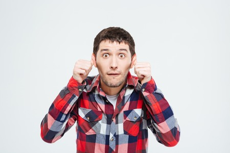 imp: Man making a silly monkey face isolated on a white background Stock Photo