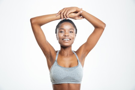 american sport: Smiling afro american woman looking at camera isolated on a white background