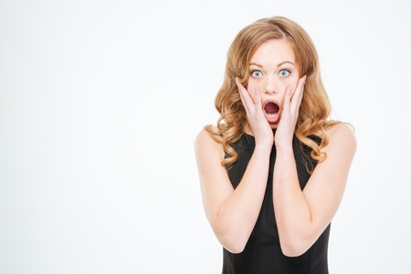Amazed woman looking at camera isolated on a white background