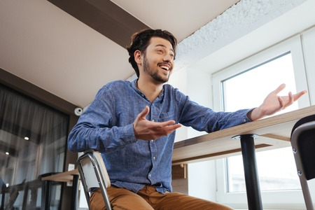 somebody: Happy man talking with somebody in office Stock Photo