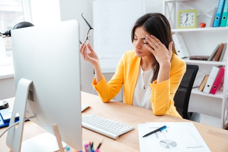 head pain: Businesswoman having head pain in office