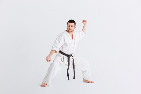 Male fighter standing in defensive stance isolated on a white background