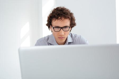 handome: Handome businessman using laptop computer in office