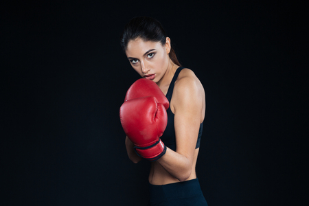 female boxer: Female boxer posing on black background