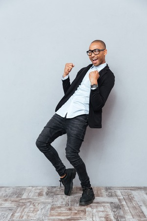 african business: Cheeful african american young man celebrating success Stock Photo