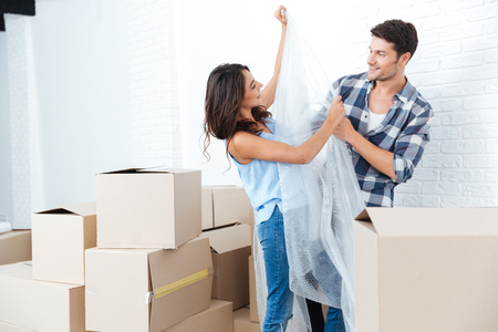 WRAP: Young pretty couple moving in new flat and having fun