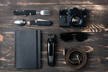 men's clothing: Trip concept - items of mens clothing and accessories on the desk