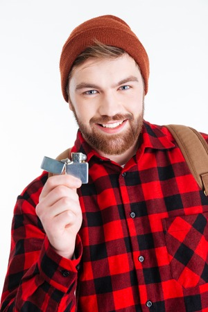 gas lighter: Happy hipster man holding gas lighter and looking at camera