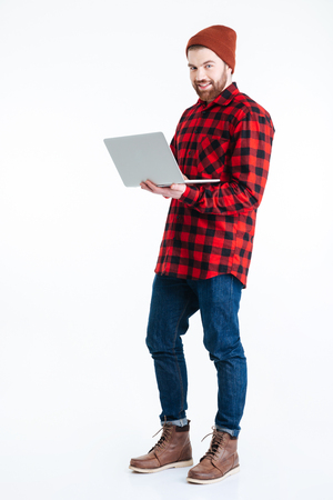 Handsome bearded man with laptop pc isolated on the white background