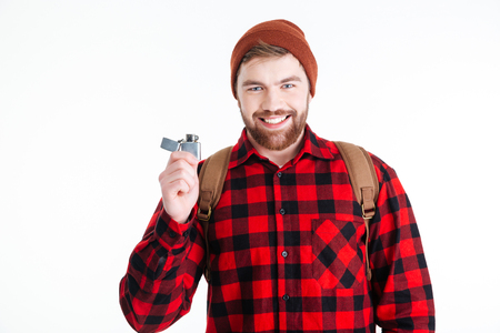 gas lighter: Smiling casual man holding gas lighter and looking at camera
