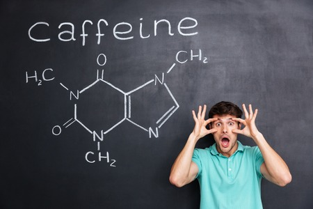hormone  male: Funny crazy young professor of chemistry standing and shouting over chalkboard background Stock Photo