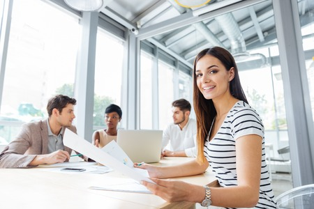 sucessful: Cheerful sucessful young woman on business meeting in conference room