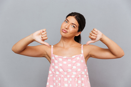 Smiling woman pointing finger at herself isolated on a white background Stock Photo