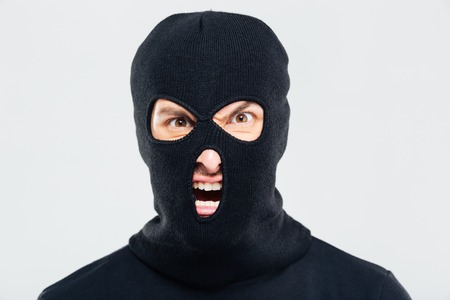 Portrait of mad furious man in balaclava Stock Photo