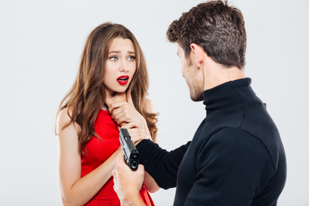 Man with gun choking and threatening to woman