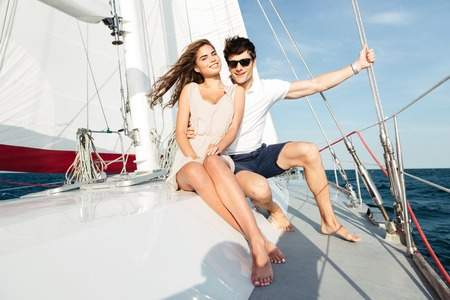 Young beautiful married couple embracing on the yacht on vacation Stock Photo