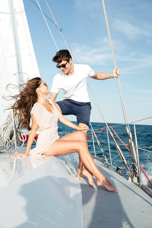 cruise travel: Young beautiful married couple relaxing together on the yacht