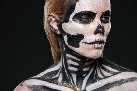 terrifying: Closeup of girl with terrifying halloween makeup over black background