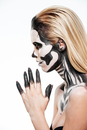 terrifying: Profile of girl with terrifying halloween makeup over white background