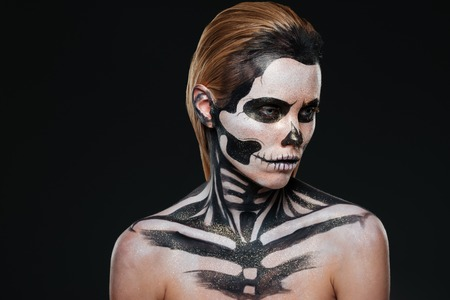 intimidating: Portrait of woman with intimidating halloween makeup over black background