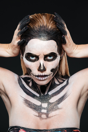 Woman with skeleton halloween makeup over black background Stock Photo