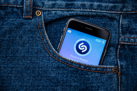catchy: MONTREAL, CANADA - MARCH 20, 2016 - Shazam mobile songs application. Shazam is a free application that helps users figure out the name of a catchy song