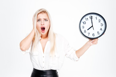 Surprised blonde businesswoman clock isolated on a white background Stock Photo