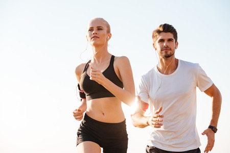 Young couple runners training together outdoors Stock Photo