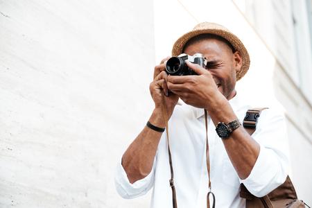 analogue: Black man photographs on the street Stock Photo