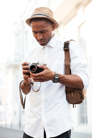 captured: Afro american with camera. on the street