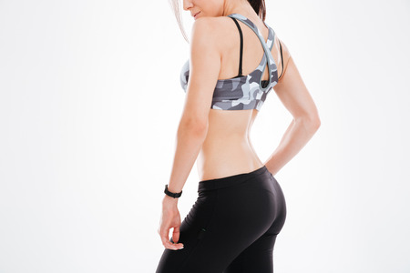 cropped: Side view of fitness woman. cropped image. isolated white background