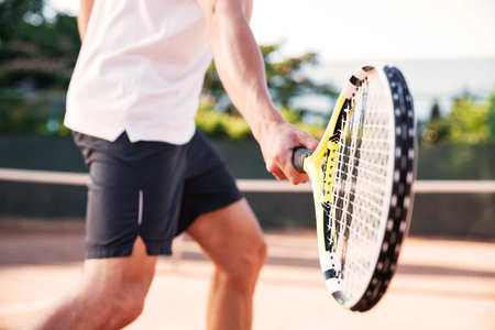 Man playing in tennis on court. cropped image Stock Photo