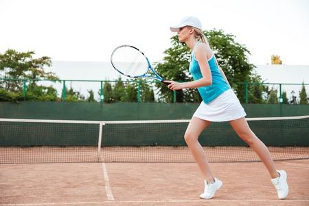 full length portrait: Tennis model in profile. full length portrait Stock Photo