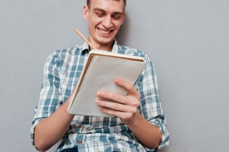 Happy student with notebook. looking at notebook. from below image Stock Photo
