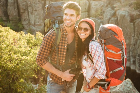 Image of adventure couple near the canyon. smiling happy couple Reklamní fotografie