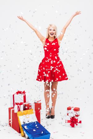 Christmas girl with tinsel. near gift bags
