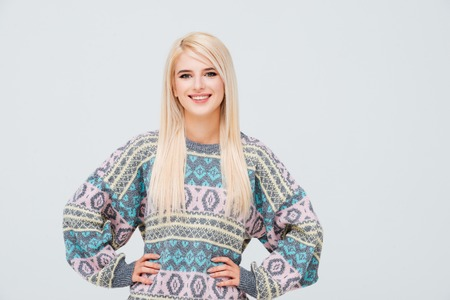 Beauty model in sweater. hands on the sides Stock Photo